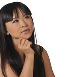 Portret van een vrouw die omhoog voor een antwoord kijkt Royalty-vrije Stock Afbeeldingen