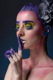 Portret van een vrouw met creatieve samenstelling Royalty-vrije Stock Afbeeldingen