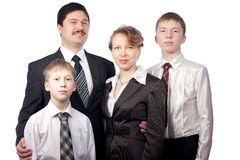 Portret van familie van vier mensen in kostuums Stock Fotografie