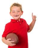 Portret van gelukkig kind met geïsoleerde voetbal stock afbeelding