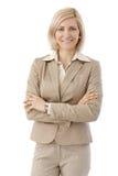 Portret van gelukkige beambte in beige kostuum Stock Afbeeldingen