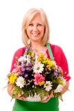 Portret van glimlachende gelukkige bloemist Royalty-vrije Stock Foto's