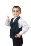 Portret van glimlachende jongen met omhoog duim Stock Afbeelding