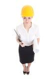 Portret van grappige bedrijfsvrouwenarchitect in gele bouwer hel Royalty-vrije Stock Foto