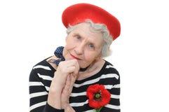 Portret van grootmoeder in rode baret Stock Foto