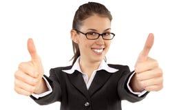Portret van het aantrekkelijke jonge vrouwelijke student tonen duimen omhoog Stock Afbeelding