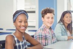 Portret van het glimlachen schoolkinderen Stock Fotografie