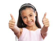 Portret van het jonge meisje tonen duimen omhoog royalty-vrije stock afbeeldingen