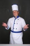Portret van het knappe chef-kok workwear dragen Royalty-vrije Stock Afbeeldingen