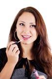 Portret van het smilling van vrouw met lipgloss Stock Afbeeldingen