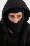 Portret van inbreker die balaclava dragen Stock Foto