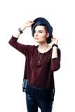 Portret van jong zwart-haired modieus meisje met hoed Royalty-vrije Stock Foto's
