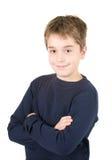 Portret van jonge glimlachende bevindende jongen Stock Afbeeldingen