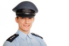 Portret van jonge glimlachende politieagent Stock Afbeeldingen