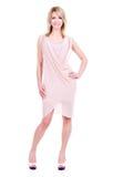 Portret van jonge glimlachende vrouw in roze kleding royalty-vrije stock fotografie