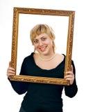 Portret van jonge vrolijke vrouw in frame Royalty-vrije Stock Afbeeldingen