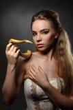Vrouw en slang Stock Foto's