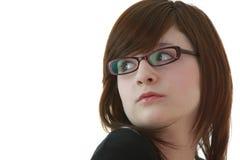 Portret van jonge vrouwelijke tiener in glazen Stock Foto