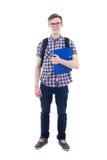 Portret van knappe tiener met rugzak en geïsoleerd boek Stock Afbeelding