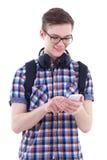Portret van knappe tiener met rugzak, telefoon en headph Stock Afbeelding