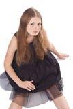 Portret van langharige meisjeszitting op de vloer Royalty-vrije Stock Fotografie