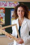 Portret van leraar in blouse in school Stock Foto