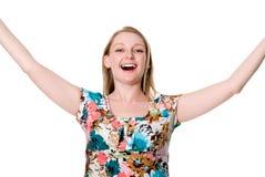 Portret van leuke gelukkige jonge dame die haar wapens uitspreiden Stock Foto