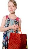 Portret van meisje met document zakken voor het winkelen. Stock Fotografie