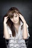 Portret van melancholische jonge vrouw Stock Foto's
