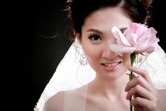 Portret van mooi meisje met bloem op haar gezicht Royalty-vrije Stock Foto