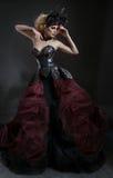Portret van mooie blonde vrouw in donker sexy korset royalty-vrije stock foto's