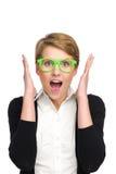 Portret van mooie jonge vrouw die in groene glazen verrast kijken. Royalty-vrije Stock Afbeeldingen