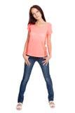 Portret van mooie jonge vrouw in jeans Royalty-vrije Stock Afbeeldingen