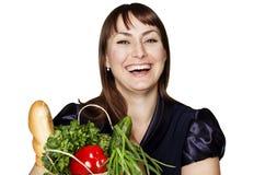 Portret van mooie vrouw met een zak van producten Stock Afbeeldingen