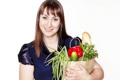 Portret van mooie vrouw met een zak van producten Stock Foto's