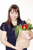 Portret van mooie vrouw met een zak van producten Stock Afbeelding