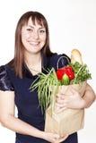 Portret van mooie vrouw met een zak van producten Royalty-vrije Stock Foto's