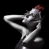 Portret van mooie vrouw met zilveren bodyart Royalty-vrije Stock Foto's
