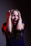 Portret van ongelukkig gillend tienermeisje Stock Fotografie