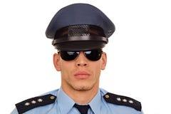 Portret van politieagent bij zonnebril Stock Afbeelding