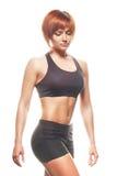 Portret van roodharigevrouw in sportkleding Het schot van de studio Royalty-vrije Stock Afbeelding