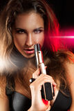 Portret van sexy jonge volwassen vrouw met kanon Royalty-vrije Stock Foto