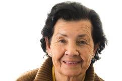 Portret van snoepje die van gelukkige grootmoeder houden stock foto