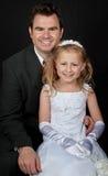 Portret van vader en dochter op zwarte royalty-vrije stock afbeeldingen