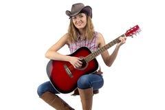 Portret van vrouw het spelen gitaar royalty-vrije stock foto's