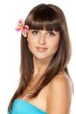 Portret van wijfje met bloem over haar oor royalty-vrije stock foto's