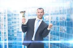 Portret van zakenman met gouden kop Royalty-vrije Stock Foto's