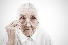 Grootmoeder met glazen stock afbeeldingen