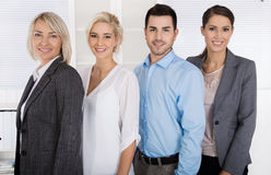 Portret: vrouwelijke werkgever met haar personeel Succesvol team Stock Foto's