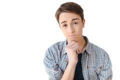 portret wzburzony caucasian nastoletni chłopak patrzeje kamerę z ręką na podbródku obrazy stock